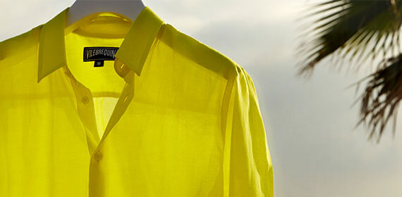 A yellow linen shirt hanging near the sea