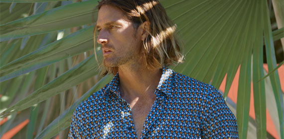 A man wearing a light shirt in printed cotton voile