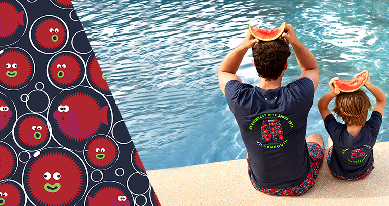 A father and son near a pool wearing a swimwear with a Vilebrequin t-shirt and holding a watermelon