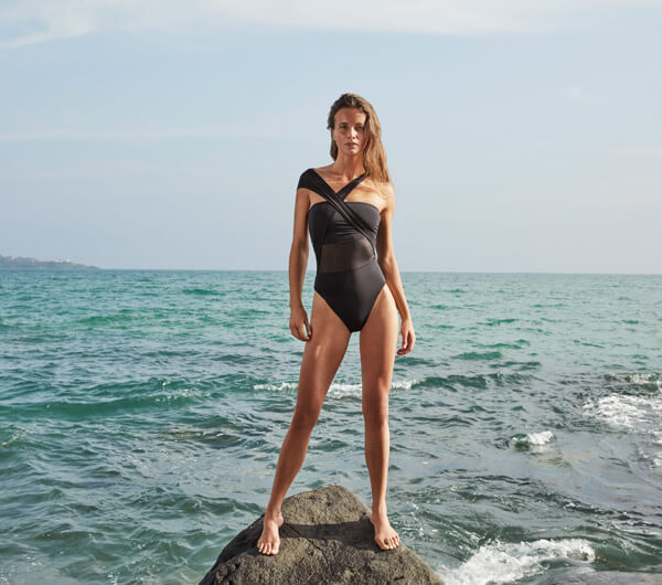 A woman wearing a one-piece swimsuit