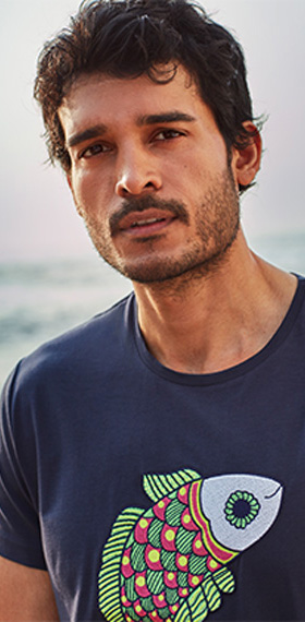 A man wearing navy blue T-shirt printed with Sweet Fish pattern