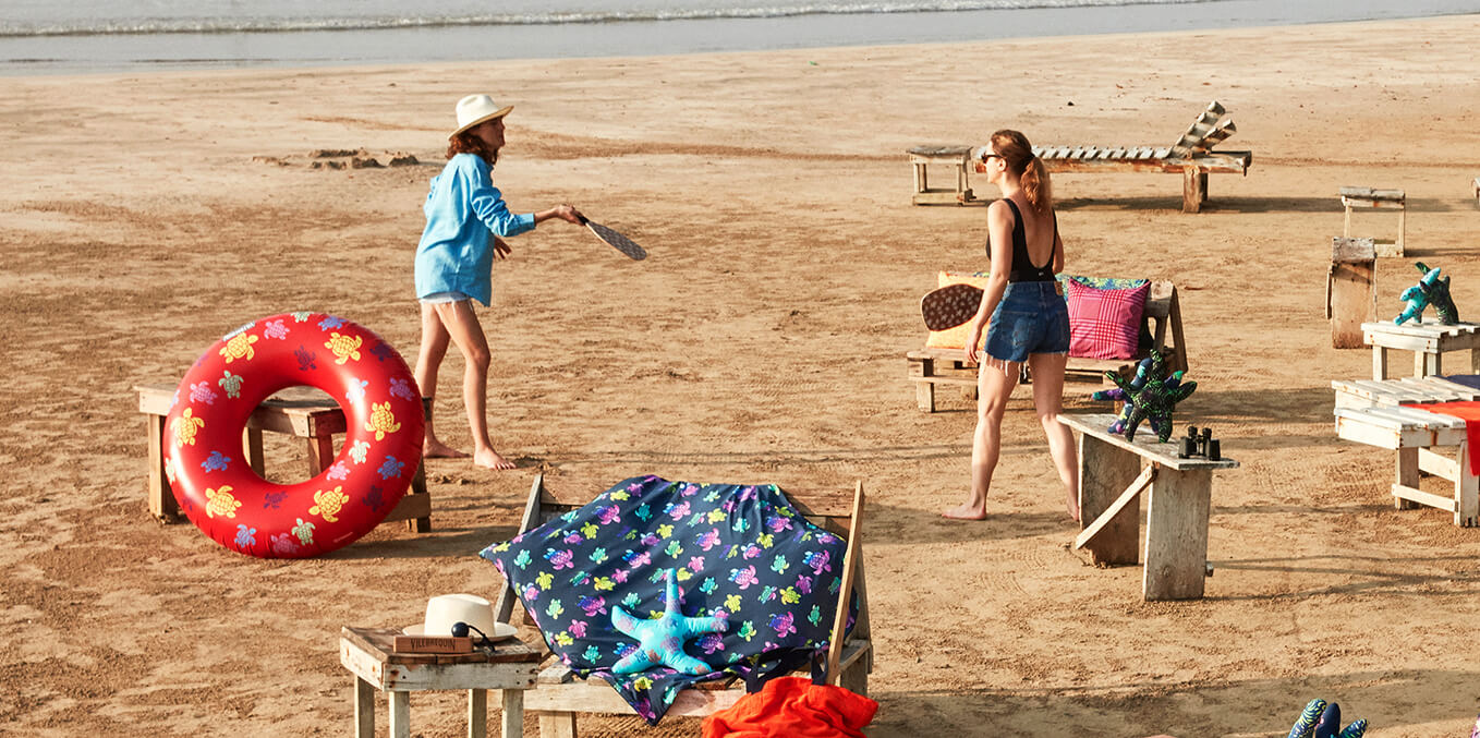 Women playing with wooden beach rackets